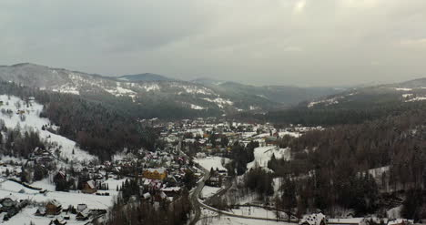 Forest-Covered-With-Snow-Aerial-View-Aerial-View-Of-Village-In-Mountains-16