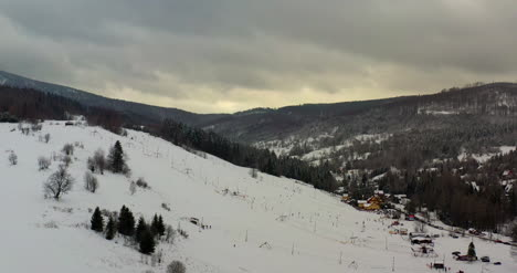 Forest-Covered-With-Snow-Aerial-View-Aerial-View-Of-Village-In-Mountains-18