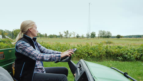 Woman-Farmer-Rides-A-Small-Grader-On-The-Field