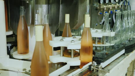 Wine-Bottles-Closed-With-A-Cork-Stopper-Move-Along-The-Conveyor-Belt-View-From-Above