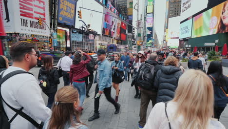 Walk-In-A-Crowd-Of-Tourists-Through-The-Famous-Times-Square-In-New-York