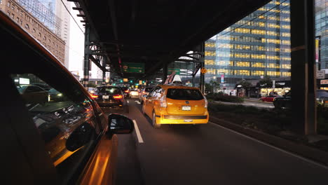 Yellow-Cab-Rides-Under-One-Of-The-Bridges-Of-New-York-Busy-Traffic-To-The-City-Rush-Hour