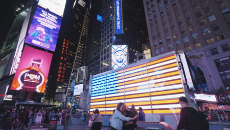 People-Walk-And-Take-Pictures-On-The-Famous-Times-Square-In-New-York