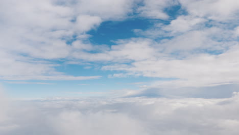 View-From-The-Window-Of-The-Plane-To-The-Clouds-And-Blue-Sky