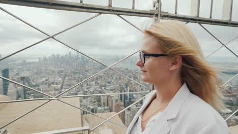 Rear-View-Of-A-Woman-Admiring-New-York-City-From-A-High-Point