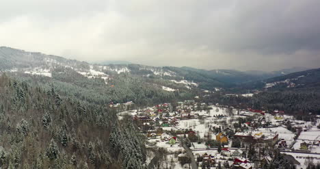 Forest-Covered-With-Snow-Aerial-View-Aerial-View-Of-Village-In-Mountains-19