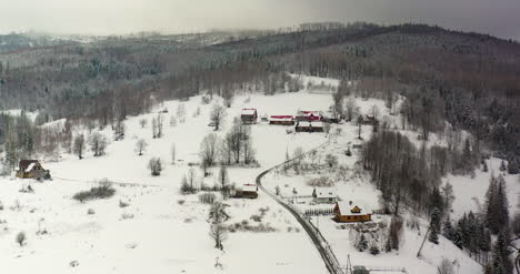Forest-Covered-With-Snow-Aerial-View-Aerial-View-Of-Village-In-Mountains-20