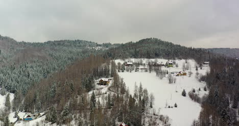 Forest-Covered-With-Snow-Aerial-View-Aerial-View-Of-Village-In-Mountains-2