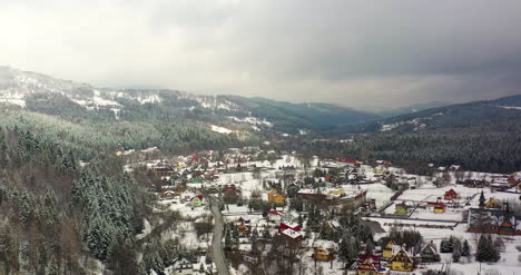 Forest-Covered-With-Snow-Aerial-View-Aerial-View-Of-Village-In-Mountains-3