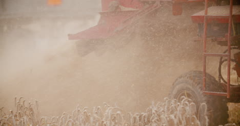 Close-Up-Of-Combine-Harvester-On-Field-At-Farm-7