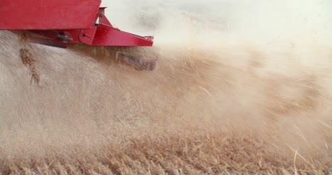 Close-Up-Of-Combine-Harvester-On-Field-At-Farm-9