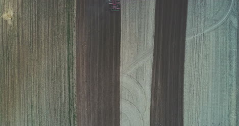 Aerial-View-Of-Tractor-Sowing-Field