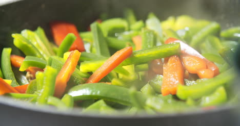 Mixing-Fresh-Vegetables-On-Pan