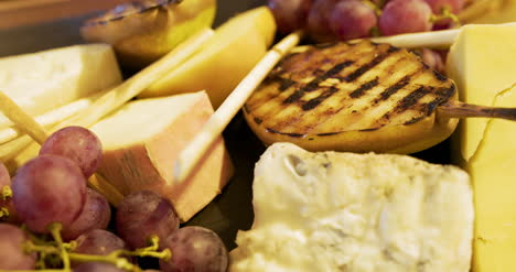 Different-Types-Of-Cheese-On-Wooden-Board-In-The-Restaurant