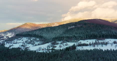 Aerial-View-Of-Forest-Covered-With-Snow-In-Mountains-7