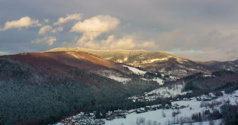 Aerial-View-Of-Forest-Covered-With-Snow-In-Mountains-8
