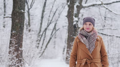 Attractive-Young-Woman-Walks-In-Snowy-Winter-Forest