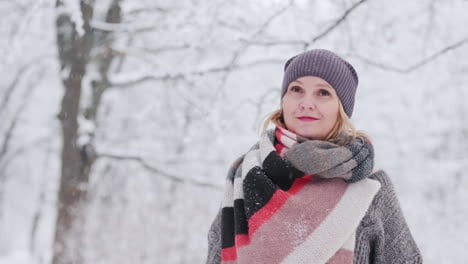 A-Young-Woman-Enjoys-A-Walk-In-The-Snowy-Forest