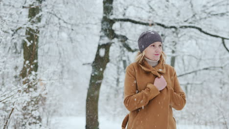 Stylish-Middle-Aged-Woman-Walks-In-Snow-Park