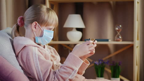 Devuka-In-A-Gauze-Bandage-Plays-On-A-Smartphone-Quarantine-And-Root-Ingesthes-At-Home-Concept