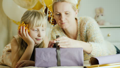 Mom-And-Daughter-Are-Packing-Presents-Together-Happy-Family-Activity-With-A-Child