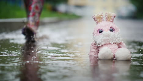 A-Damp-Plush-Bunny-Is-Sitting-In-A-Puddle-In-The-Rain-Passer-Passes-By-Indifference-And-Coldness-Con