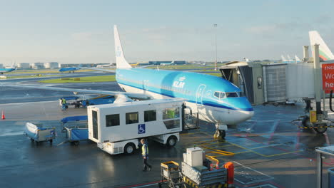 The-Klm-Air-Liner-Arrives-At-The-Airport-Terminal-The-Accordion-Gate-Joins-The-Aircraft-Door-Prepari