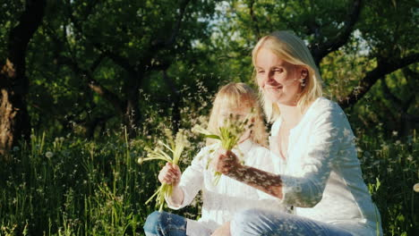 Mom-And-Daughter-Are-Playing-With-Dandelions-Have-A-Good-Time-Together-Slow-Motion-Video