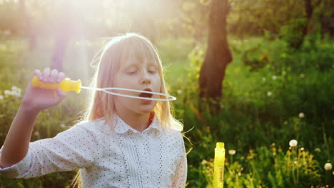 A-Carefree-Girl-Plays-With-Soap-Bubbles-Warm-Spring-Day