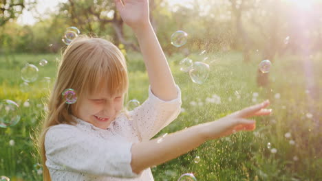 Blonde-Girl-Is-Fun-Catching-Soap-Bubbles-Carefree-Happy-Child-Slow-Motion-Video