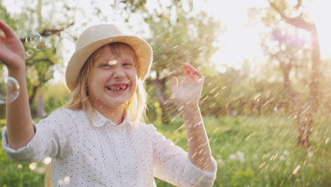 Happy-Child-Playing-With-Soap-Bubbles-Laughing