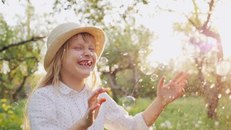 A-Cheerful-Girl-In-A-Hat-Carelessly-Plays-With-Soap-Bubbles-Happy-Spring-And-Good-Weather-Slow-Motio