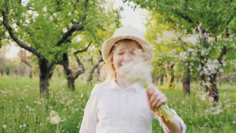 A-Happy-Child-Is-Running-Happily-Through-The-Garden-Bouncing-And-Waving-A-Bouquet-Of-Dandelions-Care