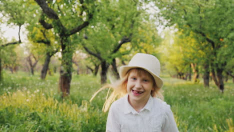 Carefree-Blonde-Girl-In-A-Hat-Runs-Through-The-Apple-Orchard-Carefree-Childhood-Concept-Slow-Motion-