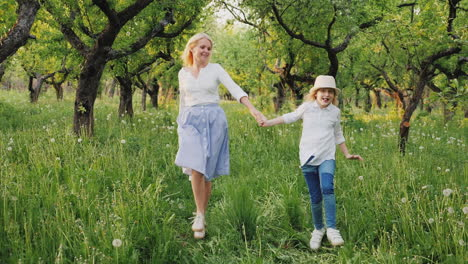 Mom-And-Daughter-Are-Running-Happily-Around-The-Garden-Having-A-Good-Time-Together