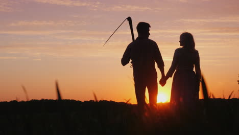 A-Family-Of-Farmers-Enjoying-The-Sunset-In-The-Field-A-Man-Is-Holding-A-Scythe-Next-To-Him-Is-His-Wi