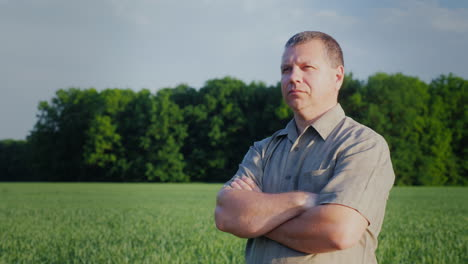 Confident-Middle-Aged-Farmer-Standing-In-The-Field-Master-Of-Business-Concept-4K-Video