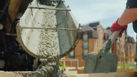 Building-A-Cottage-Workers-Take-Concrete-From-A-Mixer-Into-A-Wooden-Formwork-4K-Video