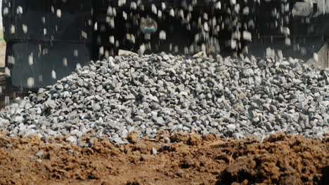 Crushed-Stone-Crumbles-To-The-Ground-From-The-Truck-Body-Delivery-Of-Building-Materials-4K-Video