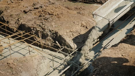 Concrete-Flows-Through-The-Pipe-Into-The-Foundation-Of-The-Basement-Construction-Of-Cottages-Concept