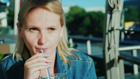 A-Woman-Drinks-A-Cocktail-From-A-Straw-Relax-On-The-Summer-Terrace-In-The-Cafe-4K-Video