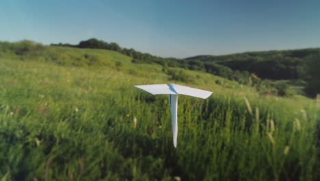 A-Real-Paper-Airplane-Is-Flying-Over-A-Picturesque-Valley-Pov-Video