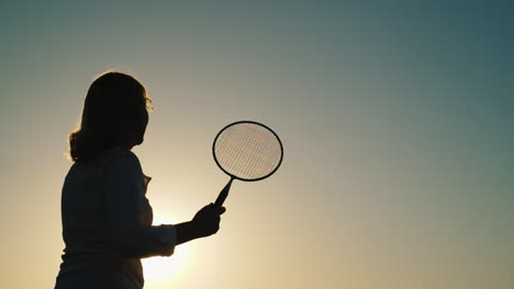 Young-Woman-Playing-Badminton-At-Sunset-Active-Vacation-Outdoor-Games-Concept-4K-Video
