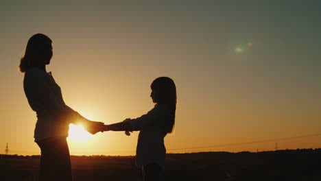 Mom-Holds-Her-Daughter-s-Hands-Stand-Alone-At-Sunset-Single-Parent-Concept-4K-Video
