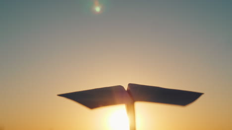 A-Paper-Airplane-Is-Flying-In-The-Sky-To-Meet-The-Setting-Sun