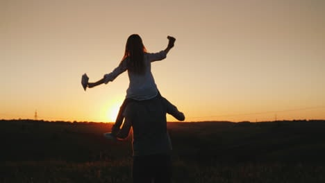 Happy-Father-Playing-With-His-Daughter-At-Sunset