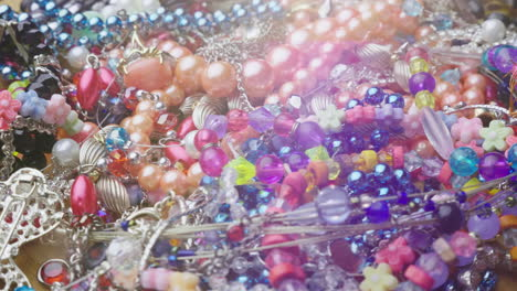 Many-Different-Female-Jewelry-Colored-Beads-And-Bracelets-4K-Video