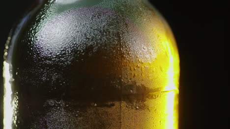 A-Glass-Bottle-Of-A-Cold-Drink-Slowly-Rotates-Drops-Of-Condensed-Moisture-Flow-Down-It-Cold-Beer-Con