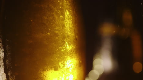 Background-With-Bottles-Of-Cold-Drinks-Or-Beer-Drops-Of-Water-Run-Down-The-Surface-4K-10-Bit-Video