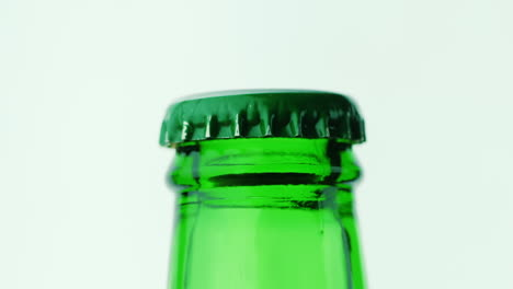 The-Neck-Of-A-Glass-Bottle-With-A-Drink-Is-Covered-With-A-Green-Lid-Hd-Video